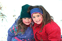 Sisters smiling after ice skating at Bracket Park age 4 and 6.  Minneapolis  Minnesota USA