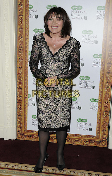 Lorraine Kelly.The 2012 Specsavers National Book Awards, Mandarin Oriental Hyde Park Hotel, Knightsbridge, London, England..December 4th, 2012.full length black dress lace cleavage smiling .CAP/CAN.©Can Nguyen/Capital Pictures.