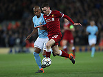 Andrew Robertson of Liverpool takes on Fernandinho of Manchester City during the Champions League Quarter Final 1st Leg, match at Anfield Stadium, Liverpool. Picture date: 4th April 2018. Picture credit should read: Simon Bellis/Sportimage
