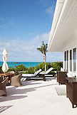 EXUMA, Bahamas. The outdoor deck of the Hill House which is the main common area at Fowl Cay Resort.