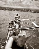 USA, Hawaii, The Big Island, Hilo, women row an Outrigger Canoe in Hilo Bay (B&W)