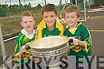 SMILES: Great smiles by Luke Murphy,Darragh Kennelly and Darach Gallagher of Derryquay NS on Thursday as they got to hold the Sam Maguire Cup...