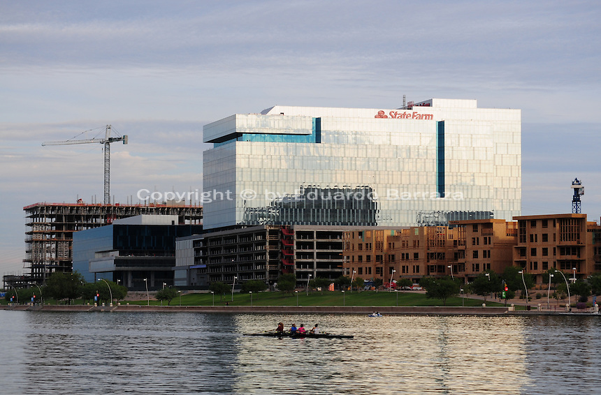 Tempe, Arizona. A southeastern view of Tempe Town Lake shows a group of people kayaking on the lake. Kayaking is a regular activity at the lake. In the background there are a series of buildings under construction, including the new State Farm building (still under construction when this photograph was taken on September 2015). Photo Eduardo Barraza © 2015