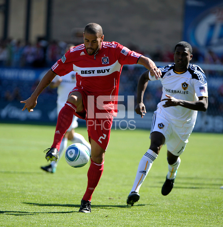 Chicago defender C.J. Brown (2) plays the ball in front of LA Galaxy forward Edson Buddle (14).  The LA Galaxy tied the Chicago Fire 1-1 at Toyota Park in Bridgeview, IL on September 4, 2010