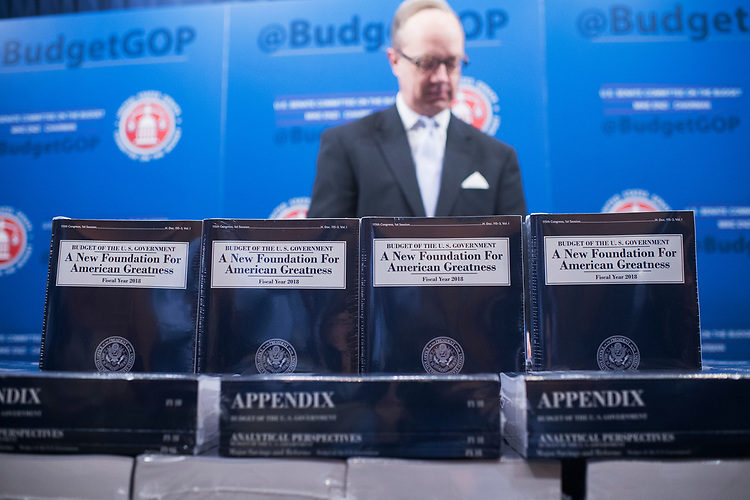 UNITED STATES - MAY 23: Eric Ueland, Republican Staff Director for the Senate Budget Committee, hands out copies of President Trump's FY2018 Budget in Dirksen Building on May 23, 2017. (Photo By Tom Williams/CQ Roll Call)