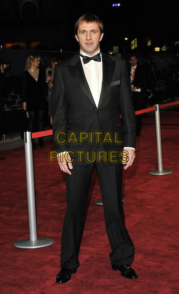 Vladimir Vdovichenkov.'360' opening gala premiere, 55th BFI London Film Festival, Odeon cinema, Leicester Square, London, England..October 12th 2011.full length black tuxedo bow tie white shir.CAP/CAN.©Can Nguyen/Capital Pictures.