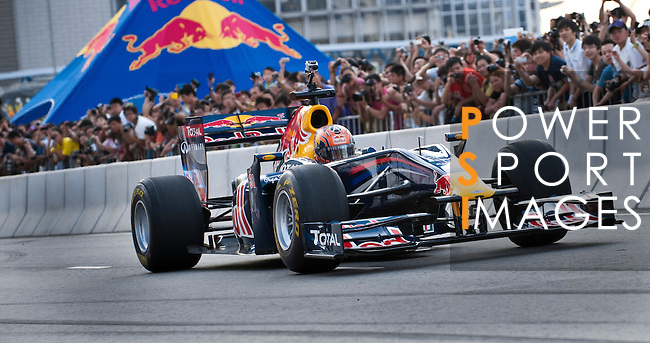 Red Bull Toro Rosso driver Jaime Alguersuari drives his Formula 1 car down Hong Kong's Lung Wo Road during the Red Bull Dragon Run 2011 in Hong Kong, China on the 18th June 2011.