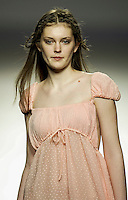A model presents a creation by Jose Miro during the Pasarela Cibeles fashion show 2005, February 17, 2005 in Madrid. Photo by Victor Fraile / studioEAST