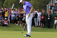 Matthew Fitzpatrick (ENG) sinks his birdie putt on the 18th green to tie the lead during Sunday's Final Round 4 of the 2018 Omega European Masters, held at the Golf Club Crans-Sur-Sierre, Crans Montana, Switzerland. 9th September 2018.<br /> Picture: Eoin Clarke | Golffile<br /> <br /> <br /> All photos usage must carry mandatory copyright credit (&copy; Golffile | Eoin Clarke)