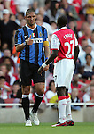 Inter Milan's Marco Materrazi offers his hand to Arsenal's Emmanuel Eboue. .Pic SPORTIMAGE/David Klein