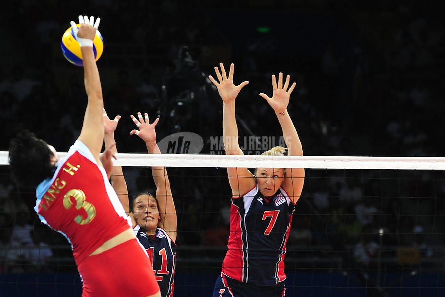 Aug. 15, 2008; Beijing, CHINA; USA players Robyn Ah Mow-Santos (11) and Heather Bown (7) defend a shot by a China player during womens volleyball pool play match at the Capital Gymnasium during the 2008 Beijing Olympic Games. Mandatory Credit: Mark J. Rebilas-