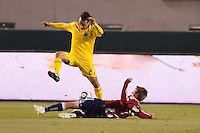 Chivas USA forward Justin Braun (17) puts the tackle on Columbus Crew defender Sebastian Miranda (21). Chivas USA and Columbus Crew played to a 0-0 tie at Home Depot Center stadium in Carson, California on  April  9, 2011....