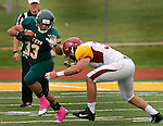 OCTOBER 4, 2014 -- Trent Butler #33 of Black Hills State tries to evad a tackler from Colorado Mesa during their Rocky Mountain Athletic Conference game Saturday at Lyle Hare Stadium in Spearfish, S.D.  (Photo by Dick Carlson/Inertia)