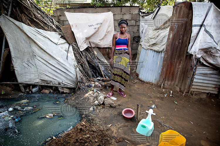 Assucena Guamba (14) stands near her toilet in Chamanculo D.