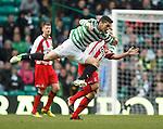 Celtic's Tony Watt with Liam Kelly