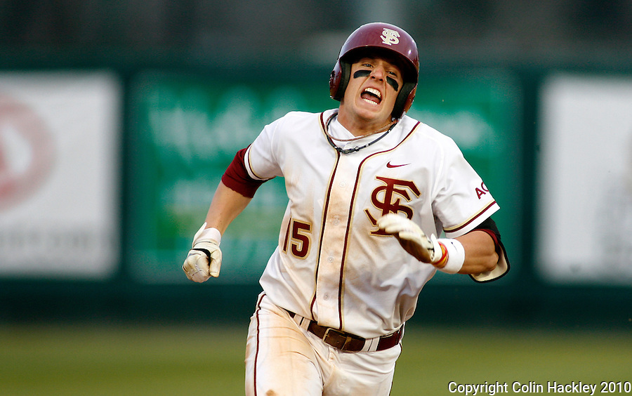TALLAHASSEE, FL 10-FSU-GA.ST. BASE10 CH24-Florida State's Tyler Holt digs for third as he earns his triple in the sicth inning against Georgia State Friday at Dick Howser Stadium in Tallahassee. The Seminoles beat the Panthers 11-3 in the 2010 season opener...COLIN HACKLEY PHOTO