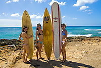 Three young women about to surf at Makaha