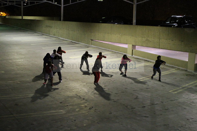 Delta Sigma Theta sorority practices for the University of Kentucky Homecoming Step Show on Monday, Oct. 17, 2011 in Lexington, Ky. They practiced in an empty parking garage.  Photo by Latara Appleby | Staff ..