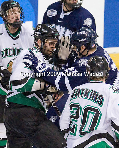 Joe Finley (UND - 2), James van Riemsdyk (UNH - 21) - The University of New Hampshire Wildcats defeated the University of North Dakota Fighting Sioux 6-5 (OT) in the 2009 Northeast Regional semifinal on Saturday, March 28, 2009, at the Verizon Wireless Center in Manchester, New Hampshire.