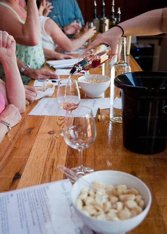 Visitors pack a wine tasting bar at Blenheim Vineyards.