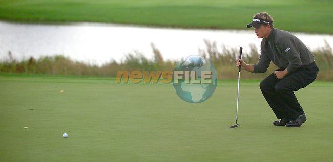 THOMASTOWN, IRELAND. Luke Donald ENG lineing up his putt on the 18th during the American Express Championship day two at the Mount Juliet Golf Club on October 1th, 2004 in Thomastown, Ireland ..Photo AFP/NEWSFILE/EOIN CLARKE..(Photo credit should read Eoin Clarke/NEWSFILE/AFP)...This Picture has been sent you under the condtions enclosed by:.Newsfile Ltd..the Studio,.Millmount Abbey,.Drogheda,.Co Meath..Ireland..Tel: +353(0)41-9871240.Fax: +353(0)41-9871260.GSM: +353(0)86-2500958.email: pictures@newsfile.ie.www.newsfile.ie.FTP: 193.120.102.198..This picture is from Fran Caffrey@newsfile.ie