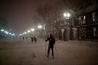 A man cross country skis through Harvard Square in Cambridge, Massachusetts, USA, as Winter Storm Nemo approaches on Friday, Feb. 8, 2013.