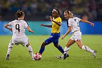Ester, Heather O'Reilly, Heather Mitts. The USWNT defeated Brazil, 1-0, to win the gold medal during the 2008 Beijing Olympics at Workers' Stadium in Beijing, China.