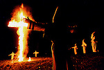 Members of the Ku Klux Klan gather during a ceremonial cross burning in rural Lawrence County, Alabama in March of 2002. The rally was held to fuel the Klan's disdain for both minorities and the Lawrence County School Board.