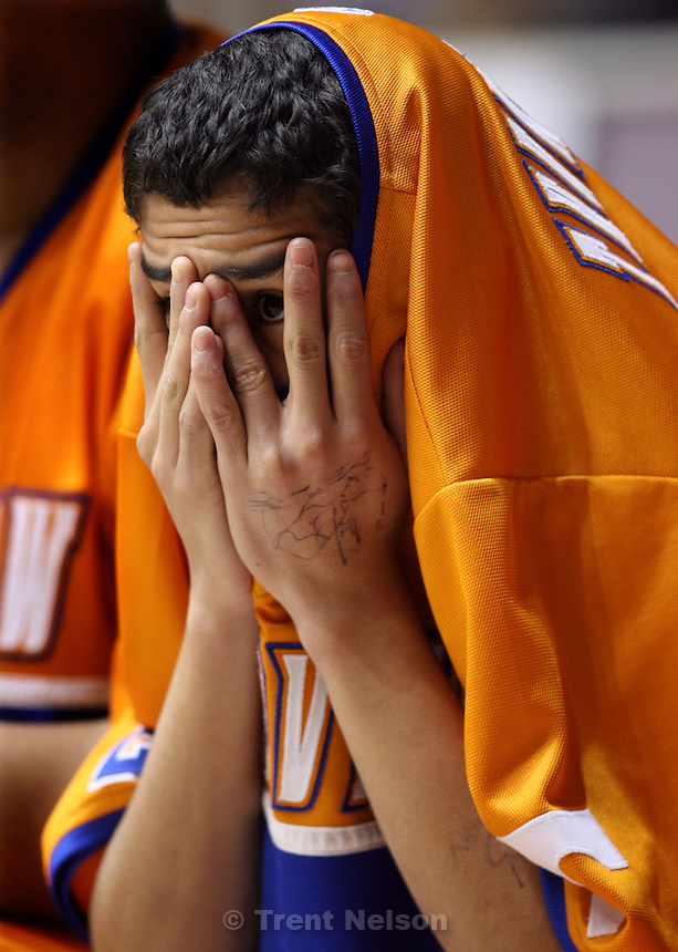 Ogden - Timpview's Chris Nash peeks out from between his fingers during the first overtime period in a his team's double-overtime loss to Payson. Payson vs. Timpview High School boys basketball, 4A State Basketball Championships at the Dee Events Center