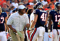 Virginia head coach Mike London reacts to Virginia wide receiver Darius Jennings (6) long punt return in the third quarter Saturday Sept. 6, 2014 at Scott Stadium in Charlottesville, VA. Virginia defeated Richmond 45-13. Photo/Andrew Shurtleff