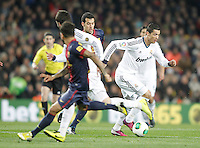 FC Barcelona's Sergio Busquets (c) and Real Madrid's Cristiano Ronaldo during Copa del Rey - King's Cup semifinal second match.February 26,2013. (ALTERPHOTOS/Acero) /Nortephoto
