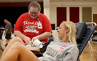 NWA Arkansas Democrat-Gazette/DAVID GOTTSCHALK  Callie Miller, a freshman at the University of Arkansas, is attended to by Heidi Griffin, with the Community Blood Center of the Ozarks, Tuesday, September 11, 2018, as she is prepared to give blood during the Muslims for Life Blood Drive to Honor 9/11 Victims inside the Verizon Ballroom in the Student Union on the campus in Fayetteville. Hosted by the Al-Islam Students Assiociation, the annual two day event was open to students, faculty and staff and has raised more than 1,000 pints of blood over the course of the blood drive at the university.