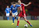 St Johnstone v Aberdeen.....07.12.13    SPFL<br /> Gwion Edwards skips by Andrew Considine<br /> Picture by Graeme Hart.<br /> Copyright Perthshire Picture Agency<br /> Tel: 01738 623350  Mobile: 07990 594431