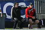 15 November 2009: NC State head coach George Tarantini (left). The University of Virginia Cavaliers defeated the North Carolina State University Wolfpack at WakeMed Stadium in Cary, North Carolina in the Atlantic Coast Conference Men's Soccer Tournament Championship game.