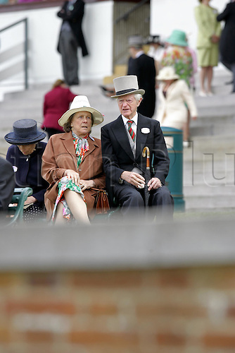 18 June 2004: Elderly couple sitting in the Royal Enclosure at Royal Ascot. Photo: Steve Bardens/Action Plus...040618 horse racing racegoers crowd old