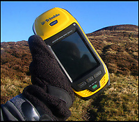 BNPS.co.uk (01202 558833)<br /> Pic: MyrddynPhilips/BNPS<br /> <br /> The Trimble GPS measuring device is incredibly accurate.<br /> <br /> Border skirmish - Amateur cartologist discovers part of Wales should actually be in England.<br /> <br /> A hillwalker has discovered that the border between England and Wales has been incorrectly marked for decades - and that England should be given more land.<br /> <br /> Myrddyn Phillips said the official border between the two countries in the Black Mountains south of Hay-on-Wye has been wrongly traced on the Ordnance Survey maps.<br /> <br /> The current border should follow the natural watershed from the summit of Twyn Llech on the nine mile long Hatterrall Ridge in the remote area.<br /> <br /> But intrepid Mr Phillips and his rambling partner Mark Trengove have remeasured the summit of the 2,308ft mountain - and found it to be 12m further west than previously thought.<br /> <br /> Although 12 metres is a seemingly small discrepancy, the area amounts to 1.8 million square feet along the entirety of the ridge.