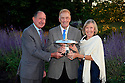 WOBURN, ENGLAND - AUGUST 30:  Nick Job of England receives the Lawrence Batley Award from Rita Firth and her husband at the annual awards dinner held at Woburn Abbey prior to the Travis Perkins plc Senior Masters played at the Duke's course, Woburn Golf Club on August 30, 2012 in Woburn, United Kingdom.  (Photo by Phil Inglis/Getty Images) *** Local Caption *** Nick Job; Rita Firth