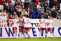 Thierry Henry (14) of the New York Red Bulls celebrates scoring with teammates . The New York Red Bulls defeated the Columbus Crew 3-1 during a Major League Soccer (MLS) match at Red Bull Arena in Harrison, NJ, on September 15, 2012.