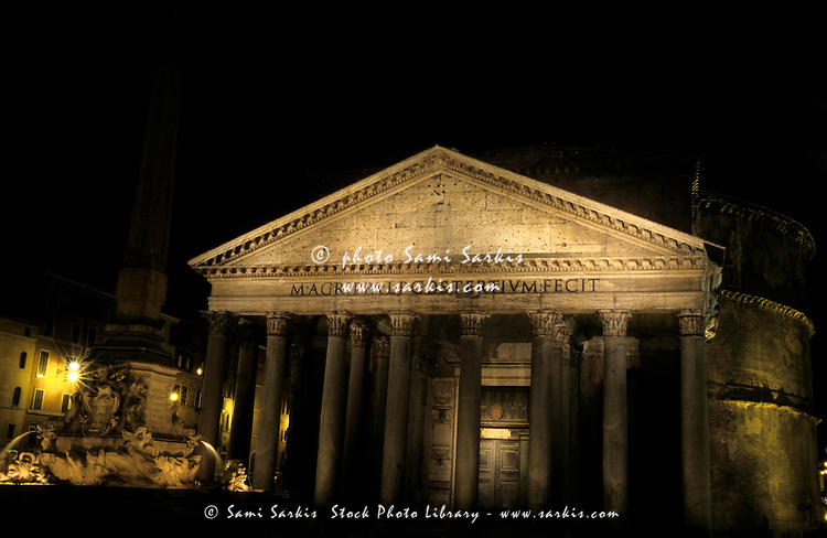 The fountain in the courtyard and the facade of the Pantheon, Rome, Italy.