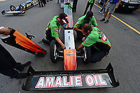 Jul, 20, 2012; Morrison, CO, USA: NHRA crew members for top fuel dragster driver Terry McMillen work on the fuel tank in the staging lanes during qualifying for the Mile High Nationals at Bandimere Speedway. Mandatory Credit: Mark J. Rebilas-