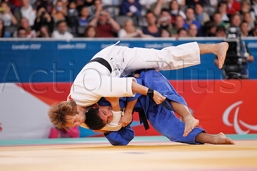 31.08.2012. London, England, 2012 Paralympic Games.   judo final action. u81 kilo Jose Effron (ARG) blue, throws Olexandr Kosinov (UKR) in the u81kilo final.