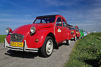 Small old cars along dike or levee, Holland, Netherlands