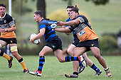 Rhain Strang is scragged by Waikato Maka. Counties Manukau Premier Counties Power Club Rugby Round 2, Game of the Week, between Te Kauwhata and Onewhero, played at Te Kauwhata on Saturday March 17th 2018. <br /> Photo by Richard Spranger.<br /> <br /> Onewhero won the game 43 - 10 after leading 21 - 10 at halftime.<br /> Te Kauwhata EnviroWaste  10 - Lani Latu try,  Caleb Brown 1 conversion, Caleb Brown 1 penalty.<br /> Onewhero 43 - Jackson Orr 2, Ilaisa Koaneti 2, Vaughan Holdt, Zac Wootten, Rhain Strang tries, Vaughan Holdt 4 conversions.