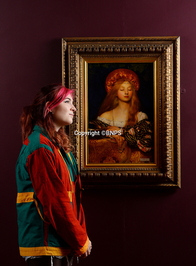 BNPS.co.uk (01202 558833)<br /> Pic: ZacharyCulpin/BNPS<br /> <br /> Pictured: Gallery visitor, Holly Bowie with the 1907 painting, 'Vanity' by Frank Cadogan Cowper. <br />  <br /> A Pre-Raphaelite exhibition opens today at the Russell Coates Gallery in Bournemouth. <br /> <br /> Beyond the Brotherhood: The Pre-Raphaelite Legacy exhibition highlights its beginings, the importance of the Pre-Raphaelite movement all the way to the high fantasty art of the Lord of the Rings and Game of Thrones. <br /> <br /> In partnership with Southampton City Art Gallery and featuring loans from the Victoria and Albert Museum, the Royal Academy, Tate Britan the exhibition and runs until 21st June