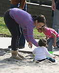 """3-14-09 Exclusive.Justine Bateman playing in a park with her son in Beverly hills ca.Bateman suffered from anorexia and bulumia for 10 years, during her """"Family Ties"""" (1982) days. ...AbilityFilms@yahoo.com.805-427-3519.www.AbilityFilms.com."""