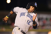 Lake County Captains shortstop Francisco Lindor #12 runs during a game against the Dayton Dragons at Fifth Third Field on June 25, 2012 in Dayton, Ohio. Lake County defeated Dayton 8-3. (Brace Hemmelgarn/Four Seam Images)