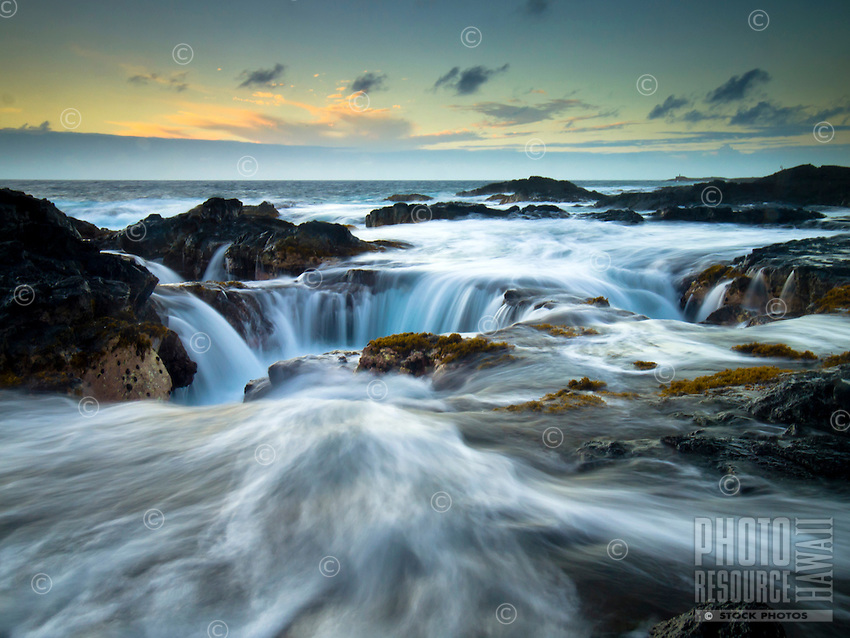 The surf chaotically rushes along the rocks of Keahole Point, Big Island.