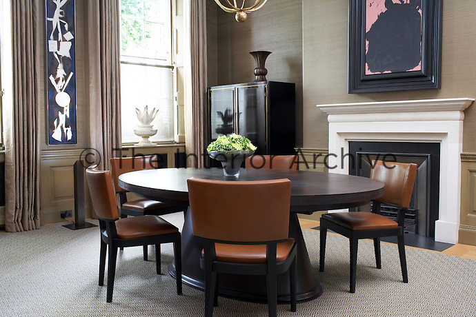 Large abstract artworks complement the classic furnishing in this contemporary dining room