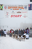 Kelley Griffin and team leave the ceremonial start line at 4th Avenue and D street in downtown Anchorage during the 2013 Iditarod race. Photo by Jim R. Kohl/IditarodPhotos.com