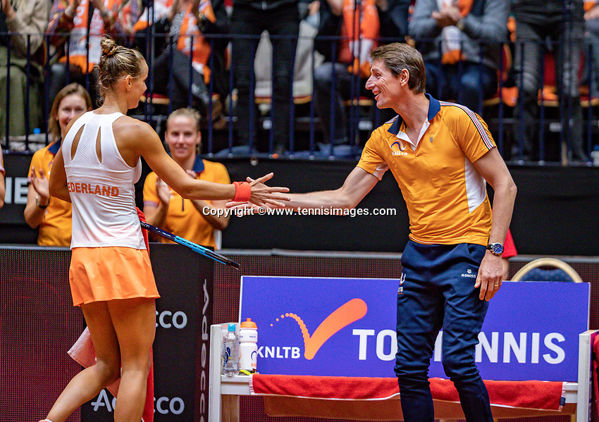 Den Bosch, The Netherlands, Februari 9, 2019,  Maaspoort , FedCup  Netherlands - Canada, second match : Arantxa Rus  (NED) is celebrati&euml;n winning the second set with captain Paul Haarhuis<br /> Photo: Tennisimages/Henk Koster
